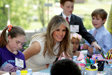 U.S. first lady Melania Trump participates in a children activity at the opening of Bunny Mellon Healing Garden at Children's National Medical Center in Washington