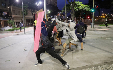 Demonstrators clash with riot police in a protest against President Michel Temer's proposal reform of Brazil's social security system during general strike in Rio de Janeiro