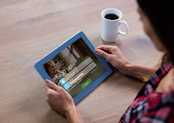Woman with coffee and tablet in login screen