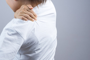 Woman putting her hand for neck and shoulder pain
