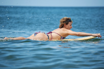 The woman surfing at the sea, summer vacation
