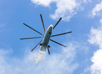 heavy cargo helicopter flying against blue sky