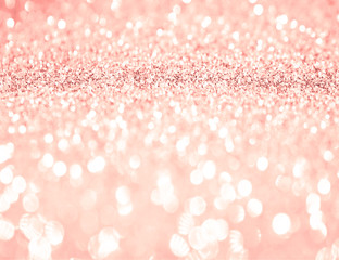 Pink rose gold glitter bokeh texture background