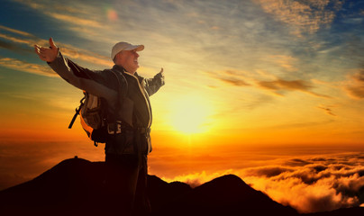 old senior man hiking successful on the top of the moutain