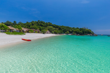 Tropical island beach and clear blue lagoon water with blue sky at Lipe Island, Satun Province South of Thailand