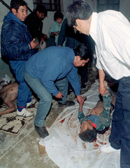 Bolivian human rights activists place the body of 14-year-old Miguel Choque next to farmer Marcial C..