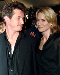 "Actors Sean Penn and his wife Robin Wright Penn pose at the premiere of her latest film, ""Message in.."