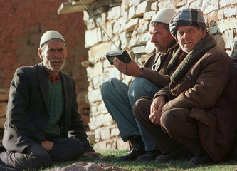 Three elderly ethnic Albanian refugees from Drenica region listen to the latest news on a radio at t..