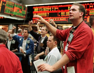 Dean McAllister, (R) a trader at the Chicago Mercantile Exchange, keeps a close eye on the board Jan..