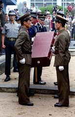 North Korean soldiers hand over to United Nations troops at the treaty village of Panmunjom a casket..