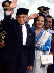 INDONESIAN PRESIDENT HABIBIE AND HIS WIFE WAVE IN JAKARTA.