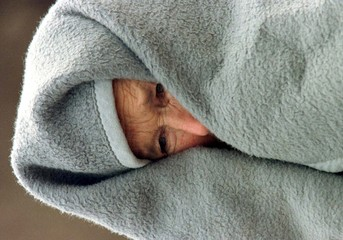 AN ETHNIC ALBANIAN WOMAN COVERS HERSELF.