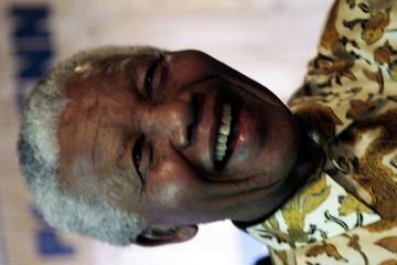 NELSON MANDELA SMILES AT WORLD ECONOMIC FORUM IN DAVOS.