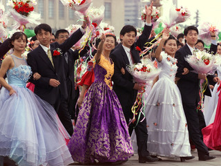 PARTICIPANTS DRESSED AS WEDDING COUPLES WALK THROUGH TIANANMEN SQUARE DURING NATIONAL DAY PARADE IN ...