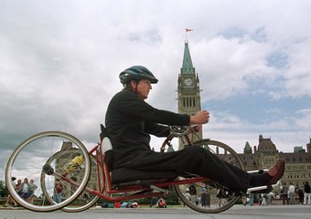 PARAPLEGIC RYAN ARRIVES AT PARLIAMENT HILL ON CYCLE TOUR ACROSS CANADA.