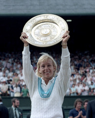 US TENNISWOMAN NAVRATILOVA HOLDS WIMBLEDON SINGLES PLATE ALOFT AFTER BEATING US PLAYER EVERT-LLOYD IN LONDON.
