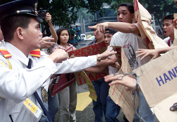 A FILIPINO SECURITY GUARD SCUFFLE WITH STUDENTS IN MANILA.