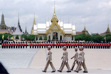 A group of royal guards march past an ornate pavillion on the Sanam Luang cremation ground during a ..