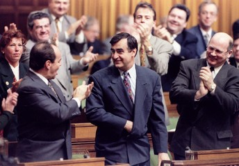 Bloc Quebecois Leader Lucien Bouchard receives a standing ovation from his caucus colleagues in the ..