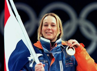 Marianne Timmer of the Netherlands shows her gold medal during the awarding ceremony of the women's ..