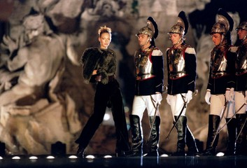 Models display Gianfranco Ferre's Spring/Summer 96-97 collection in Rome September 23. Singers and d..