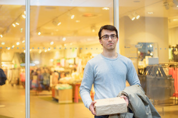 Man with present during shopping