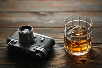 Old rangefinder camera and whiskey