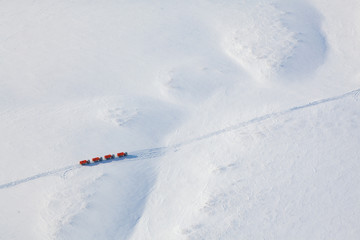 Trucks in winter tundra from above