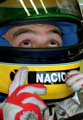 Brazil's Ayrton Senna adjusts his helmet,during practice for the Hungarian Grand Prix August 13..