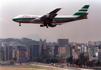 A plane approaches the runway in Hong Kong's Kai Tak international airport March 8. Cathay Pacific A..