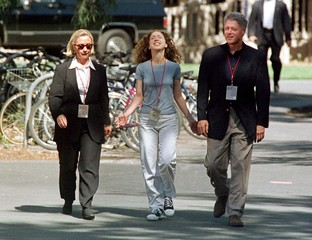 Chelsea Clinton reacts as she walks across Stanford University in Palo Alto with her parents, First ..