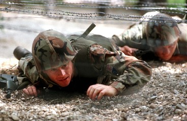 Members of a special unit of the Bosnian Moslem-Croat army exercise near Sarajevo July 10. The Unite..