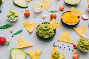 Mexican corn chips  with fresh guacamole sauce. Copy space. Top view