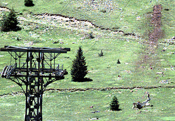 The ground is seen scarred July 2 where a Pic de Bure cable car plunged 80 metres (260 ft), killing ..