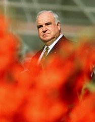 Outgoing German Chancellor Helmut Kohl is seen through roses decorating St. Peter's Square during th..