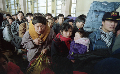 TRAVELLERS QUEUE AT BEIJINGS MAIN RAILWAY STATION TO RETURN HOME FOR NEW YEAR.