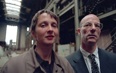 SWISS ARCHITECTS BINSWANGER AND HERZOG POSE INSIDE BANKSIDE POWER STATION IN LONDON.