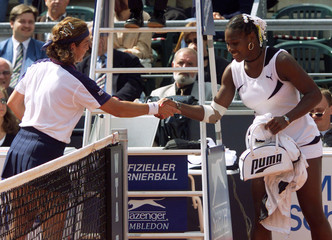 U.S. TENNIS PLAYER WILLIAMS SHAKES HAND WITH SANCHEZ VICARIO OF SPAIN AFTER RETIRED FROM THE MATCH ...