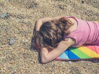 Woman sleeping on beach in summer