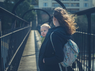 Mother with baby on bridge
