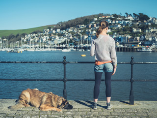 Woman with giant dog by river