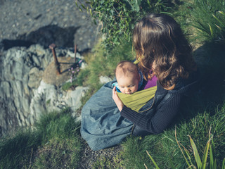 Mother with baby in nature