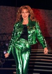 "Actress Joely Fisher who is featured on the television series ""Ellen"" models Moschino jeans and matc.."