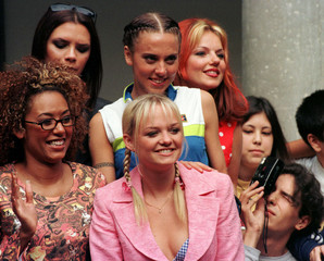 BOY TAKES PICTURE OF BRITISH POP GROUP SPICE GIRLS