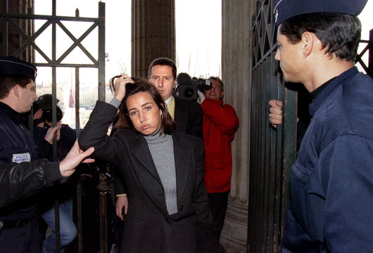 French businessman Pierre Botton (C rear) arrives at the courthouse behind his lawyer Frederique Pon..