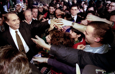 Republican presidential candidate Bob Dole greets supporters gathered at the Pinkerton Academy in De..