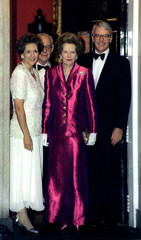 Lady Thatcher (C) is welcomed by Prime Minister John Major and his wife Norma as she arrives for a b..