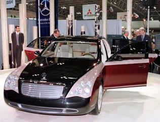 Daimler-Benz Chairman Jurgen Schrempp (2L) unveils the Maybach, which it calls the ultimate chauffeu..