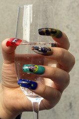 """A model displays artificial nails painted with an airbrush with the pictures of """"Mona Lisa, King Lud.."""