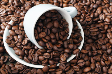 scattering of coffee beans with cup